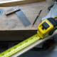 Measuring the wood for cutting.