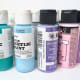 Pictured here are a few bottles of craft acrylic paint.