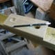 Using the base plate as a template to mark out the holes in the post.