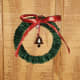 Attach a tiny bell in the middle of the small wreath.