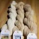 Subtle variances between white and beige alpaca yarn.
