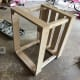 Slide the other 1x4 frame over the top of the 2x2 posts and screw it into place.