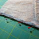 "Using a 1/4"" seam, pin down each side for a finished look."