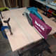 Sanding the board flat and smooth with a belt sander