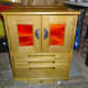 Completed sewing machine cabinet in workshop with doors and lid closed