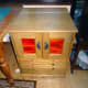 Sewing machine cabinet with view of top lid and piano hinge