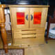 Completed sewing machine cabinet in Conservatory with doors and lid closed