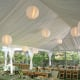 This lined frame tent with ball lights and pole drapes is actually two tents put together, which is how you get the L shape.
