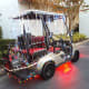 This cart is liberally draped with strings of lights and has the underbody cart lights too.
