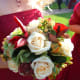 Cream white roses, berries, red foliage are gorgeous for winter bouquets.