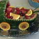 Make a watermelon baby carriage to serve your fruit.