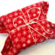 Using a blanket with creative ideas for gift wrapping.