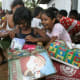 Girls excitedly unpacking their shoeboxes in Sri Lanka.