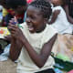 A girl holding one of her shoebox gifts in Malawi.