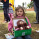 A girl showing off her shoebox in Paraguay.