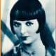Publicity photo of Louise Brooks from short biographical sketch-book Stars of the Photoplay, 1930 (public domain).