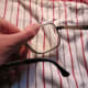 Place on a cloth to cushion, and apply pressure to lens.
