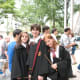 "This is an ""authentic"" Hogwarts uniform look, including books, wands, and spectacles!"