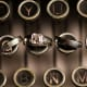 His and her wedding rings on typewriter keys