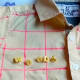 After drawing the grid, I sewed on the letter buttons to make the name Woody.
