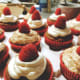 German chocolate cupcakes with vanilla frosting and fresh red raspberries