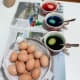 While the eggs are submerged in the dye mixes, dunk them up and down using spoons.
