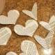 Cut out different sized hearts from old book pages.