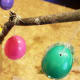 Hang your eggs on the branches. Add colorful pieces of thread, beads, or other items to customize your tree.