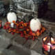 Add bling to white pumpkins, strands of leaves and a couple of lanterns to add light and color to any area of your party.