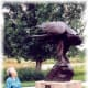 My mother viewing one of the sculptures in Benson Park