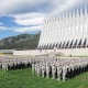 More than 1,300 basic cadets salute June 26 during their first reveille formation at the U.S. Air Force Academy in Colorado Springs, Colorado.
