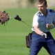 Cadet 1st Class Mike Heddinger lets the U.S. Air Force Academy mascot catch a food-laden lure during training.