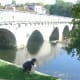 Boy on Le pont coudé, Brantome. Also called 'the right angle bridge'