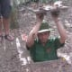 Demonstration on entering the Cu Chi tunnels in Vietnam