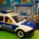 My son wanted to play with the police cars . . .
