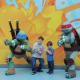 Kids getting their picture take with the Teenage Mutant Ninja Turtles