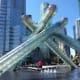 The Olympic Cauldron is located very near  to Canada Place.
