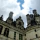 "Chambord has a central tower (or ""keep"").  The keep is surrounded by four towers and two wings (a chapel wing and a royal wing).  A curtain wall connects the structures."