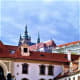 Prague Castle looms over Wallenstein Palace.