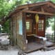 The cabin is just big enough for a couple or a single traveler, and has a spacious porch.