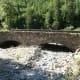 Old stone bridge near Haystack Creek for snow melt runoff