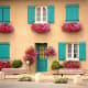 Flowers and colorful shutters.