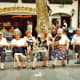 Many people line up in their chairs to watch the comings and goings as well as performances on the Las Ramblas streets.