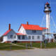 """All ships that enter and leave Lake Superior must pass the Whitefish Point Light.  It is also known as the """"Graveyard of the Great Lakes.""""  It is also home to the Great Lakes Shipwreck Museum."""