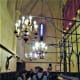Chandeliers give light to worshippers.