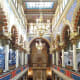 Well-lit interior of Jerusalem Synagogue.