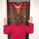 Place hands on door frame, with elbows below shoulders, and lean into door opening