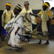 Xhosa women in their traditional garb doing a traditional dance