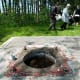 People gather around the now defunct Well 5 where the original water contamination started during a memorial ceremony in Walkerton, Ont., on Sunday, May 16, 2010. (THE CANADIAN PRESS/Nathan Denette)