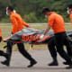 Bodies from Air Asia 8501 wreckage being transported to Surabaya
